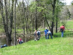 The group collects the frog and newt pond